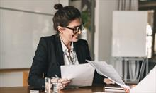 photo-of-successful-woman-holding-resume-and-negot-fbc3xht