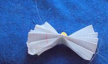 Zabawka z papieru i koralika